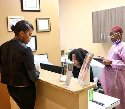 Ambiance Dental Spa dentistry patient at front desk