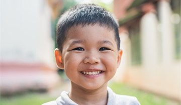 Young boy with healthy smile after children's dentistry