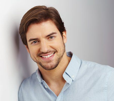 handsome man with porcelain veneers smiling