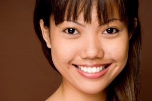 Young woman smiling after teeth whitening