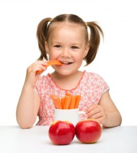 girl with carrots and apples